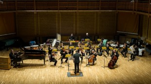 Large BCMG ensemble in concert - wide shot, front on