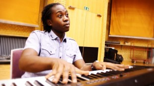 Playing keyboard at a Feel the Buzz workshop
