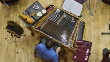 Edward Cervenka playing the cimbalom in Into the Little Hill