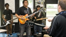 Guitarists participating in a Zigzag workshop