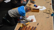 Boy creating graphic score for BCMG musicians at Musicadoodle-do