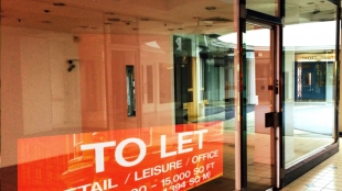 Empty shop unit with to let sign