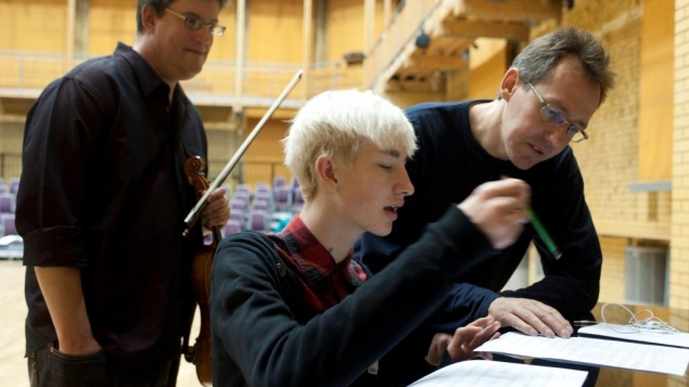 Student discussing their composition with composer Fraser Trainer and BCMG Musician