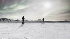 Two silhouetted characters in an arctic landscape