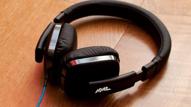 Headphones on table with NMC logo