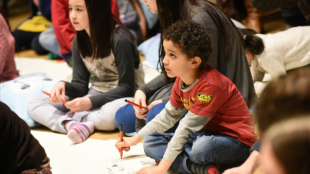 Participant drawing music at BCMG event